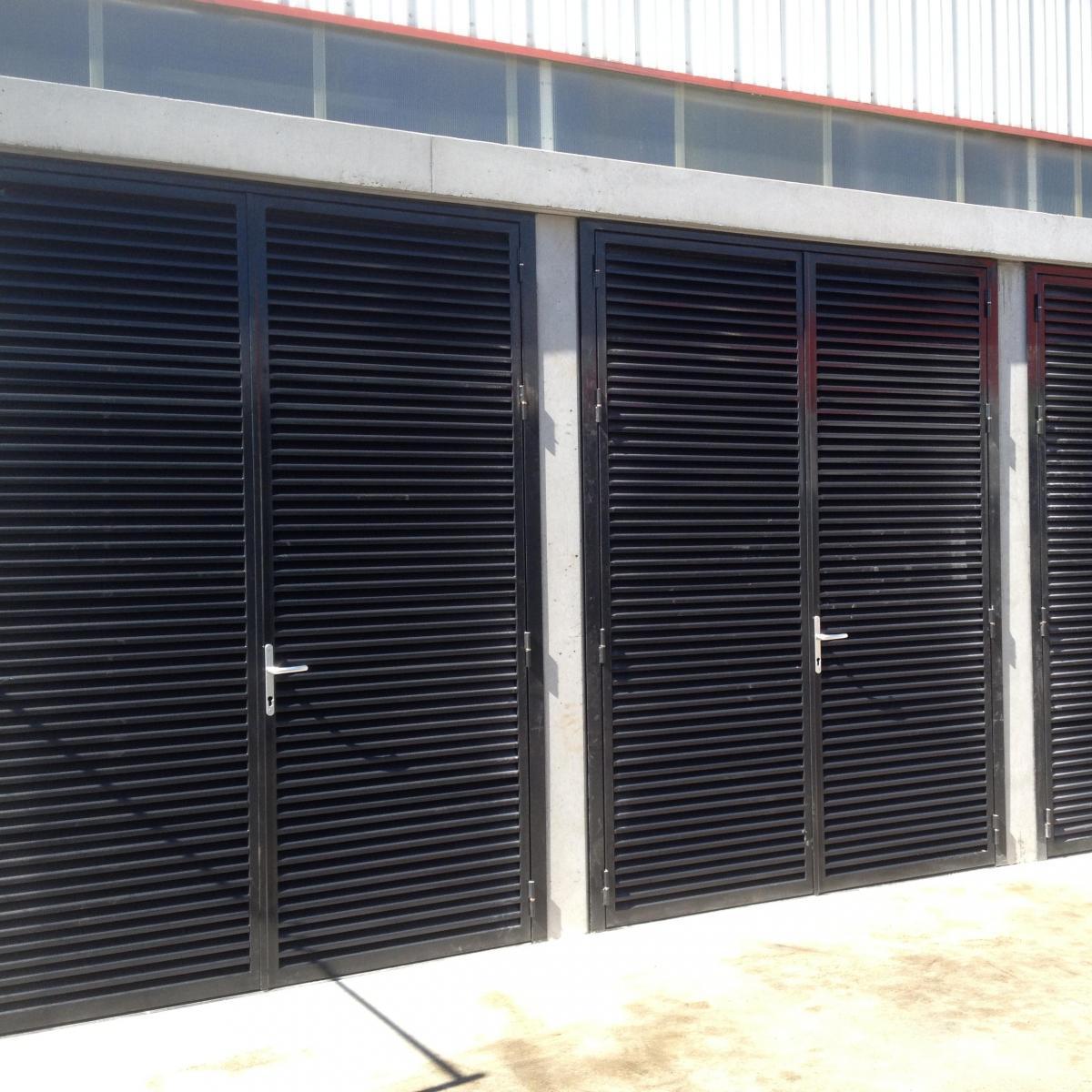 Portes à ventelles installées à l'Aigle<br>
